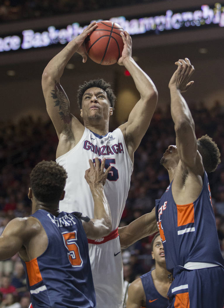 Gonzaga junior forward Brandon Clarke (15) grabs a rebound over Pepperdine sophomore guard Jade' Smith (5) in the first half during the West Coast Conference semifinal game on Monday, March 11, 20 ...