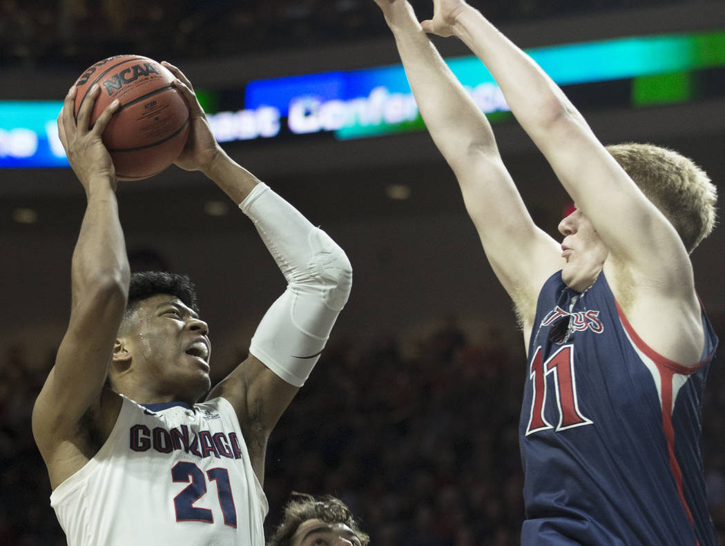 Gonzaga junior forward Rui Hachimura (21) drives over Saint Mary's freshman forward Matthias Tass (11) in the first half during the West Coast Conference finals game on Tuesday, March 12, 2019, at ...