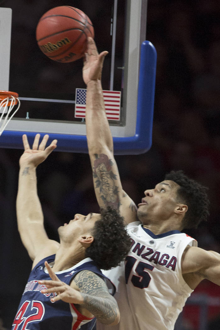 Gonzaga junior forward Brandon Clarke (15) blocks the shot of Saint Mary'sfreshman forward Dan Fotu (42) in the first half during the West Coast Conference finals game on Tuesday, March 12, ...