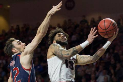 Gonzaga senior guard Josh Perkins (13) slices to the rim past Saint Mary's sophomore guard Tommy Kuhse (12) in the first half during the West Coast Conference finals game on Tuesday, March 12 ...