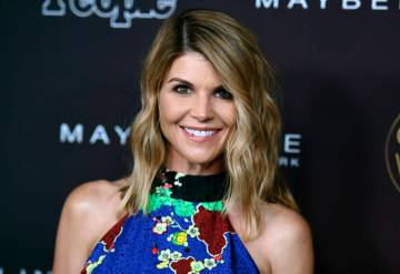 "Actress Lori Loughlin arrives at the 5th annual People Magazine ""Ones To Watch"" party in Los Angeles on Oct. 4, 2017. (Richard Shotwell/Invision/AP, File)"
