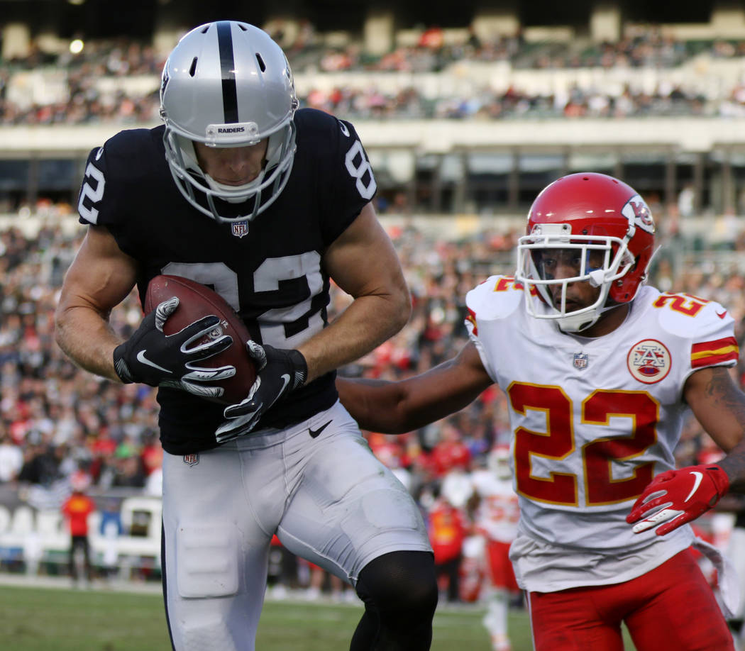 Oakland Raiders wide receiver Jordy Nelson (82) catches a pass over Kansas City Chiefs defensive back Orlando Scandrick (22) during the second half of an NFL game in Oakland, Calif., Sunday, Dec. ...