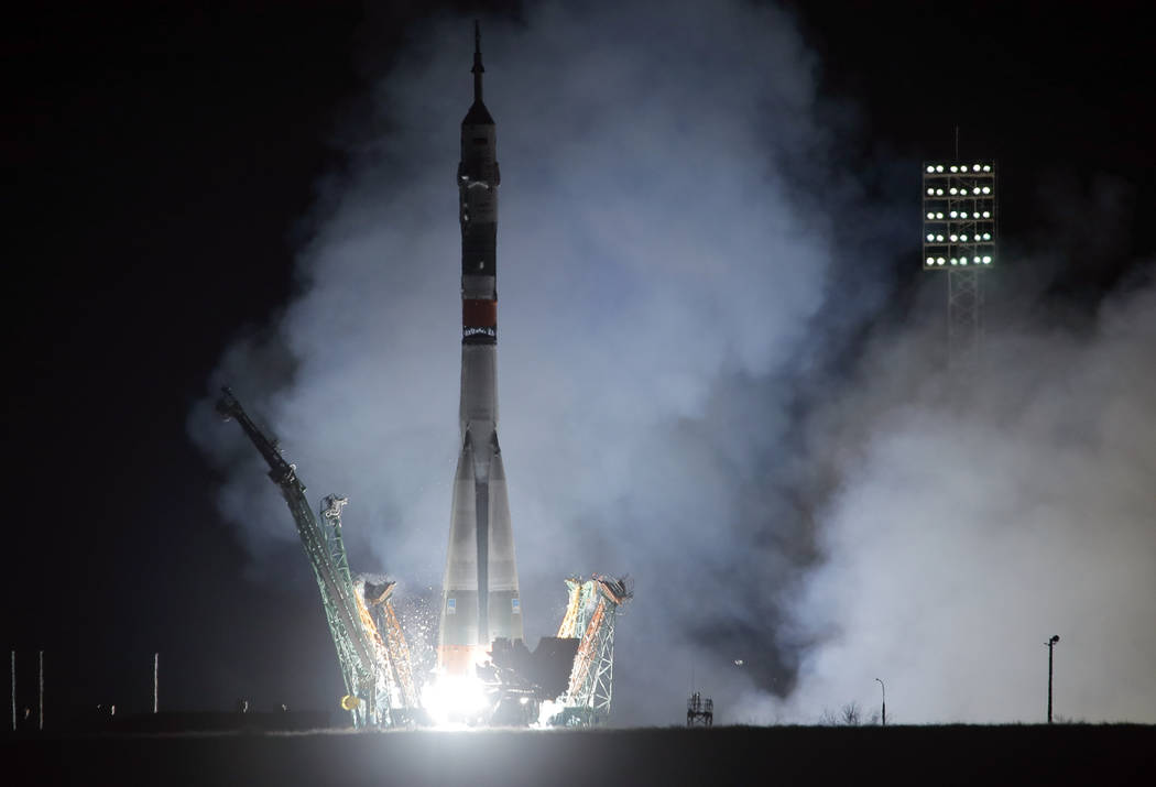 The Soyuz-FG rocket booster with Soyuz MS-12 space ship carrying a new crew to the International Space Station, ISS, blasts off at the Russian leased Baikonur cosmodrome, Kazakhstan, early Friday, ...