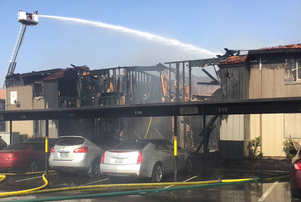 Fire crews battle a blaze at Solaire Apartments, 1750 Karen Ave., in Las Vegas on Aug. 5, 2018. (Clark County Fire Department)