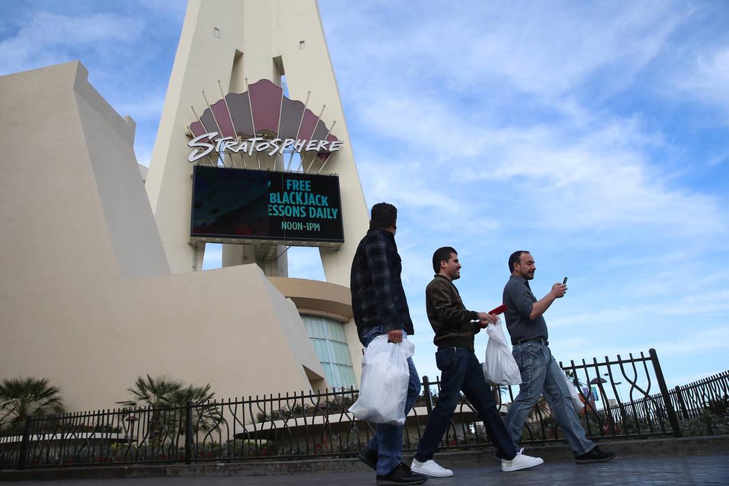 People walk outside of the Stratosphere in Las Vegas, Friday, Feb. 1, 2019. (Erik Verduzco/Las Vegas Review-Journal)