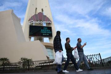 People walk outside of the Stratosphere in Las Vegas, Friday, Feb. 1, 2019. (Erik Verduzco/Las Vegas Review-Journal)