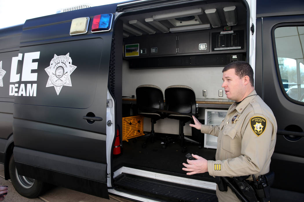Metropolitan Police Department Traffic Officer Mike Thiele shows the van used for processing and transporting alleged impaired drivers by the Metro-Nevada Highway Patrol DUI Strike Team after a ne ...