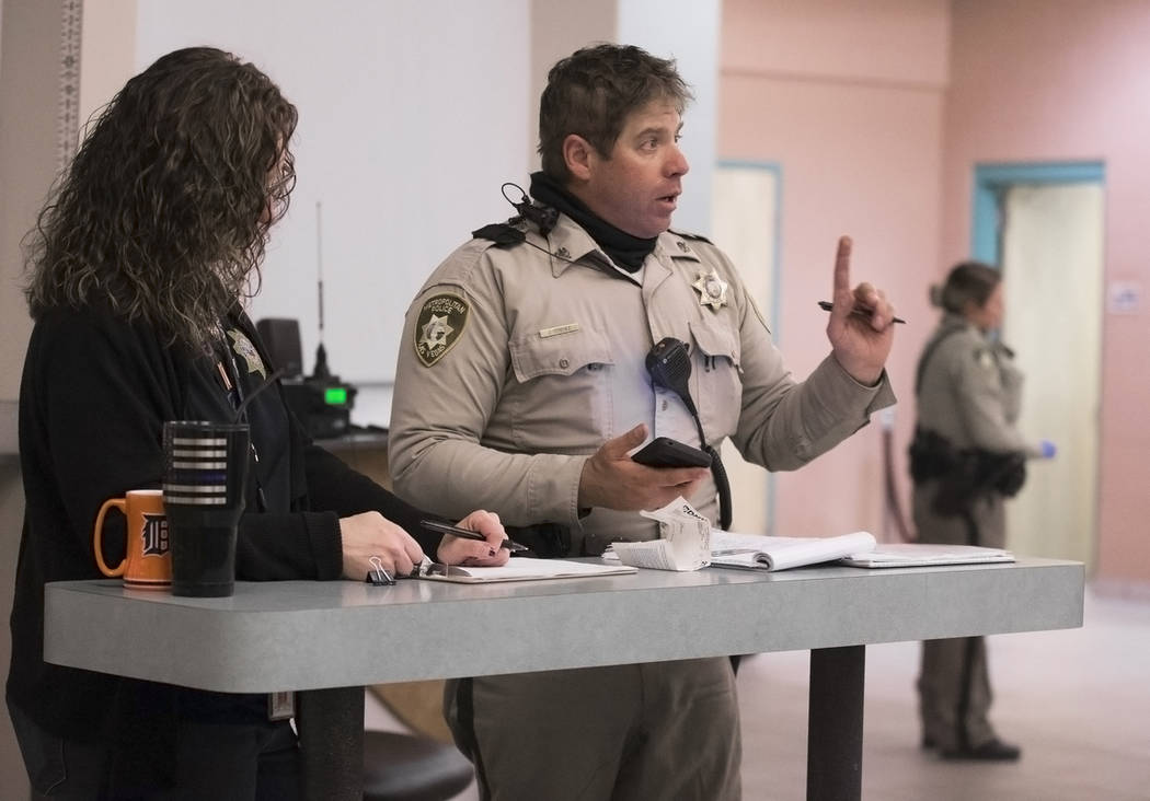 "Metro Traffic Officer Jason Strehle, middle, questions a suspected impaired driver (out of frame) at the Metro Traffic Bureau as part of a ""DUI blitz"" on Thursday, March 14, 2019, in Las ..."