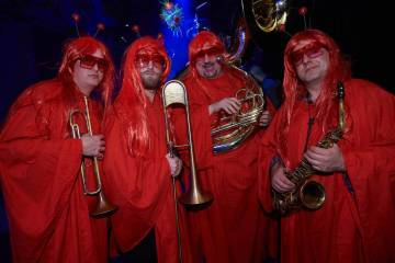 "A band that looks like a group of Heat Misers celebrate the first anniversary of ""Opium"" at the Cosmopolitan of Las Vegas on Tuesday, March 12, 2019. (Spiegelworld)"