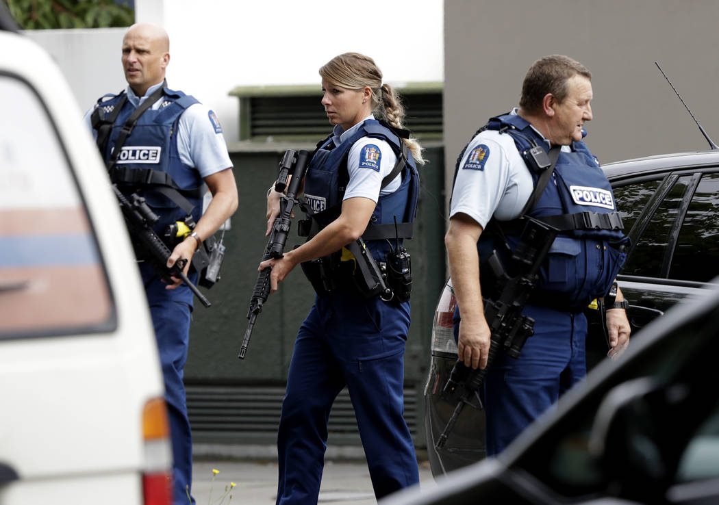 Armed police patrol outside a mosque in central Christchurch, New Zealand, Friday, March 15, 2019. A witness says many people have been killed in a mass shooting at a mosque in the New Zealand cit ...