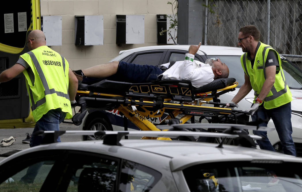 Ambulance staff take a man from outside a mosque in central Christchurch, New Zealand, Friday, March 15, 2019. A witness says many people have been killed in a mass shooting at a mosque in the Ne ...