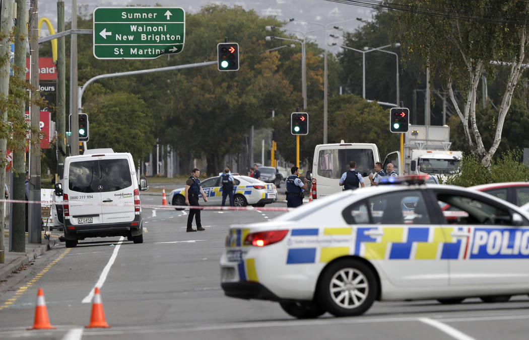 Police block the road near the shooting at a mosque in Linwood, Christchurch, New Zealand, Friday, March 15, 2019. Multiple people were killed during shootings at two mosques full of people attend ...