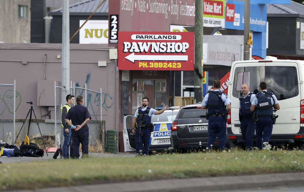Police stand outside a mosque in Linwood, Christchurch, New Zealand, Friday, March 15, 2019. Multiple people were killed during shootings at two mosques full of people attending Friday prayers. (A ...