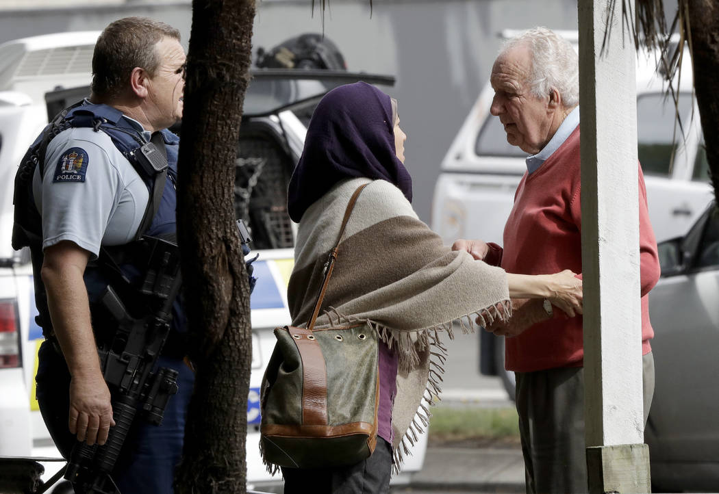 Police escort people away from outside a mosque in central Christchurch, New Zealand, Friday, March 15, 2019. Multiple people were killed in mass shootings at two mosques full of people attending ...