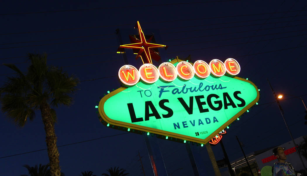 """The """"Welcome to Fabulous Las Vegas"""" sign goes green on Thursday, March 14, 2019 in celebration of St. Patrick's Day. (Mat Luschek/Las Vegas Review-Journal)"""