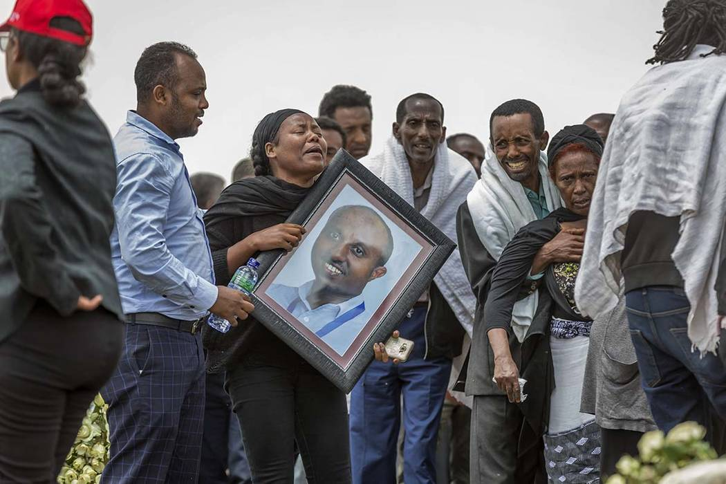 Ethiopian relatives of crash victims mourn and grieve at the scene where the Ethiopian Airlines Boeing 737 Max 8 crashed shortly after takeoff on Sunday killing all 157 on board, near Bishoftu, so ...