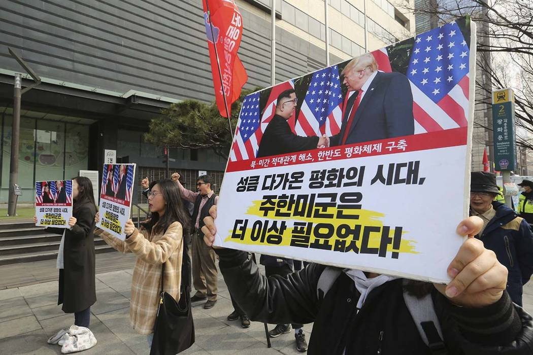In this March 2, 2019, photo, South Korean protesters with banners showing photos of U.S. President Donald Trump and North Korean leader Kim Jong Un stage a rally to denounce policies of the Unite ...