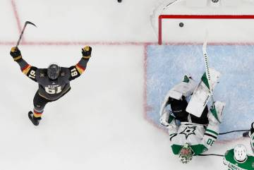 Vegas Golden Knights right wing Mark Stone (61) celebrates after left wing Max Pacioretty scored against Dallas Stars goaltender Ben Bishop (30) during the third period of an NHL hockey game Tuesd ...