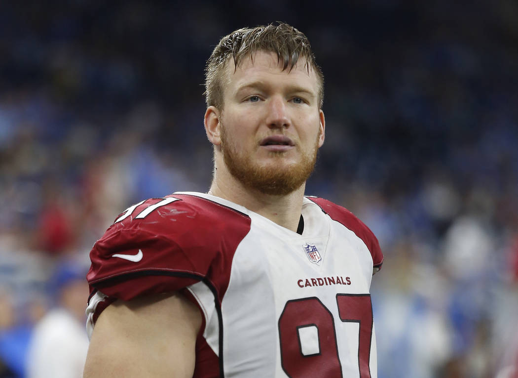 Former Arizona Cardinals defensive end Josh Mauro stands near the sideline during the team's NFL football game against the Detroit Lions in Detroit on Sept. 10, 2017. (AP Photo/Duane Burleson, File)