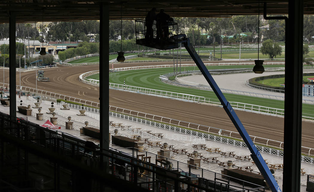 The Clockers' Corner area, the popular morning hangout for owners, trainers, jockeys and fans to watch workouts and grab breakfast, is empty at Santa Anita Park in Arcadia, Calif., Thursday, March ...