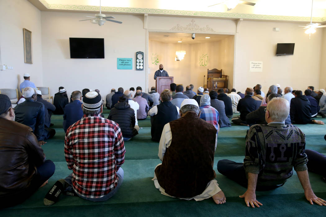 Worshipers listen to Shaykh Obair Katchi, imam of Corona Masjid in California, during a prayer service at the Mosque of Islamic Society of Nevada in Las Vegas Friday, March 15, 2019. (K.M. Cannon/ ...