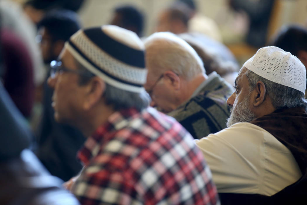 Worshipers, including Dr. Mohammad Hassan, right, listen to Shaykh Obair Katchi, Imam of Corona Masjid in California, during a prayer service at the Mosque of Islamic Society of Nevada in Las Vega ...