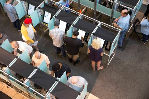 People cast their votes on the third day of early voting at the Galleria at Sunset in Henderson on Monday, Oct. 22, 2018. (Las Vegas Review-Journal)