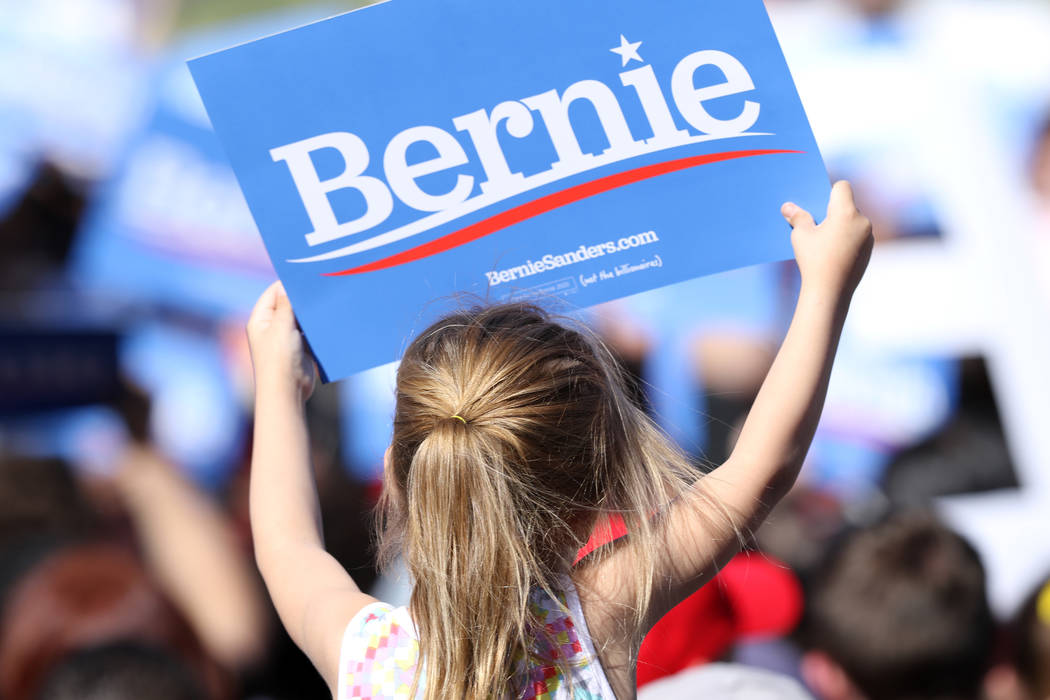 A young girl holds up a sign supporting Democratic presidential candidate Sen. Bernie Sanders at a rally in Morrell Park in Henderson on a tour to launch his presidential campaign, Saturday, March ...