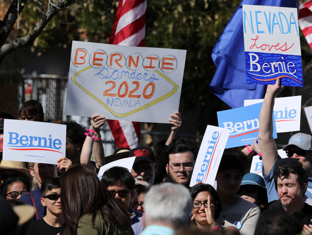 Supporters of Democratic presidential candidate Sen. Bernie Sanders' campaign hold up their posters at a rally at Morrell Park in Henderson, Saturday, March 16, 2019. (Heidi Fang /Las Vegas Review ...
