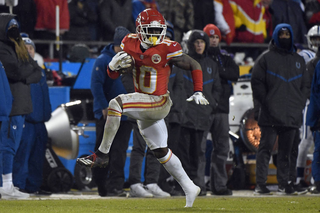 Kansas City Chiefs wide receiver Tyreek Hill (10) runs with the ball during the second half of an NFL divisional football playoff game against the Indianapolis Colts in Kansas City, Mo., Saturday, ...
