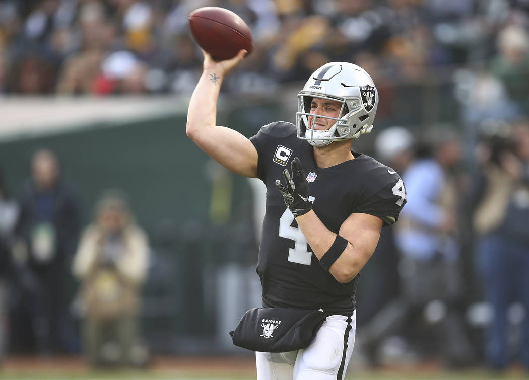 Oakland Raiders quarterback Derek Carr (4) passes against the Pittsburgh Steelers during the second half of an NFL football game in Oakland, Calif., Sunday, Dec. 9, 2018. (AP Photo/Ben Margot)