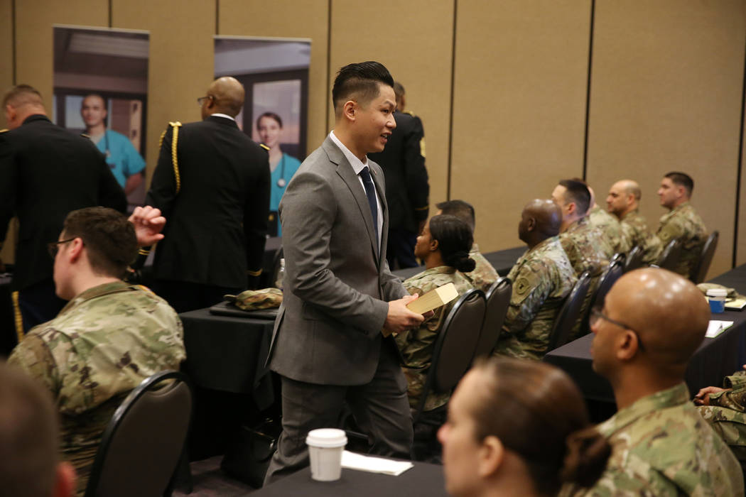 Anthony Hua after getting sworn in as captain for the U.S. Army Reserve during a ceremony at the Hampton Inn Tropicana and Event Center in Las Vegas, Friday, March 15, 2019. Hua is a general denti ...