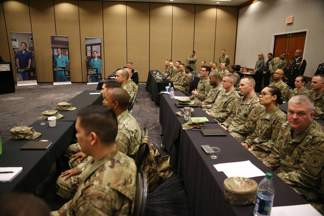 Members of the military was as Anthony Hua is sworn in as U.S. Army Reserve captain during a ceremony at the Hampton Inn Tropicana and Event Center in Las Vegas, Friday, March 15, 2019. Hua is a g ...