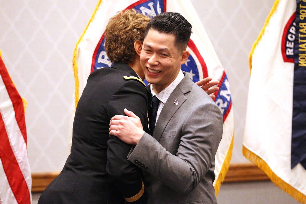 Anthony Hua embraces U.S. Army Lt. Gen. Nadja West after getting sworn in as captain for the U.S. Army Reserve during a ceremony at the Hampton Inn Tropicana and Event Center in Las Vegas, Friday ...