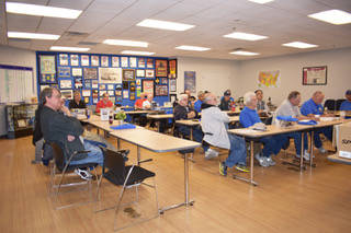 "Members of the International Plastic Modelers Society Las Vegas chapter, listen to some of the board of directors before they begin the ""show-and-tell"" portion of their meeting. (Rachel Spacek/La ..."