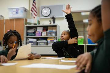 Geleah Sessoms raises her hand in her class at Rainbow Dreams Academy in Las Vegas, Tuesday, Jan. 15, 2019. (Caroline Brehman/Las Vegas Review-Journal)