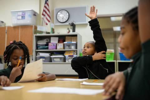 Geleah Sessoms raises her hand in her class at Rainbow Dreams Academy in Las Vegas, Tuesday, Jan. 15, 2019. (Caroline Brehman/Las Vegas Review-Journal)