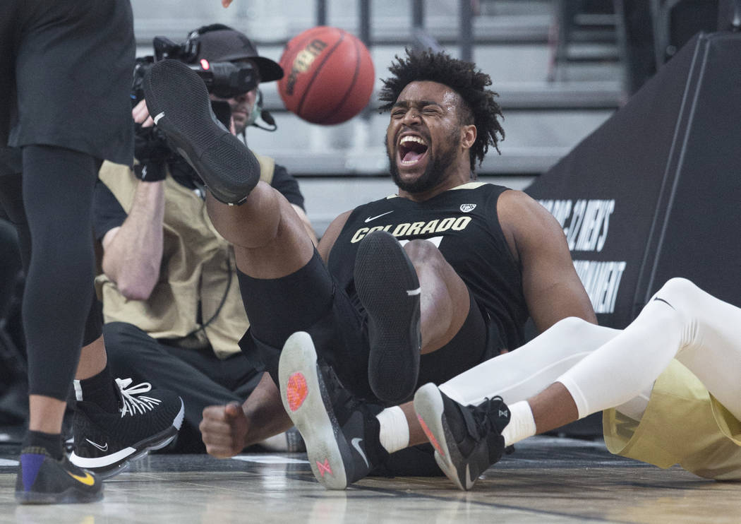 Colorado freshman forward Evan Battey (21) celebrates after taking a charge during the the Buffalos Pac-12 tournament semifinal game with Washington on Friday, March 15, 2019, at T-Mobile Arena, i ...