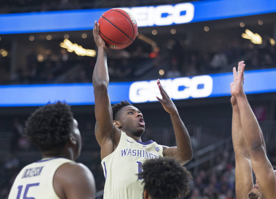 Washington sophomore forward Nahziah Carter (11) drives past a Colorado defender in the second half during the Huskies semifinal game of the Pac-12 tournament on Friday, March 15, 2019, at T-Mobil ...