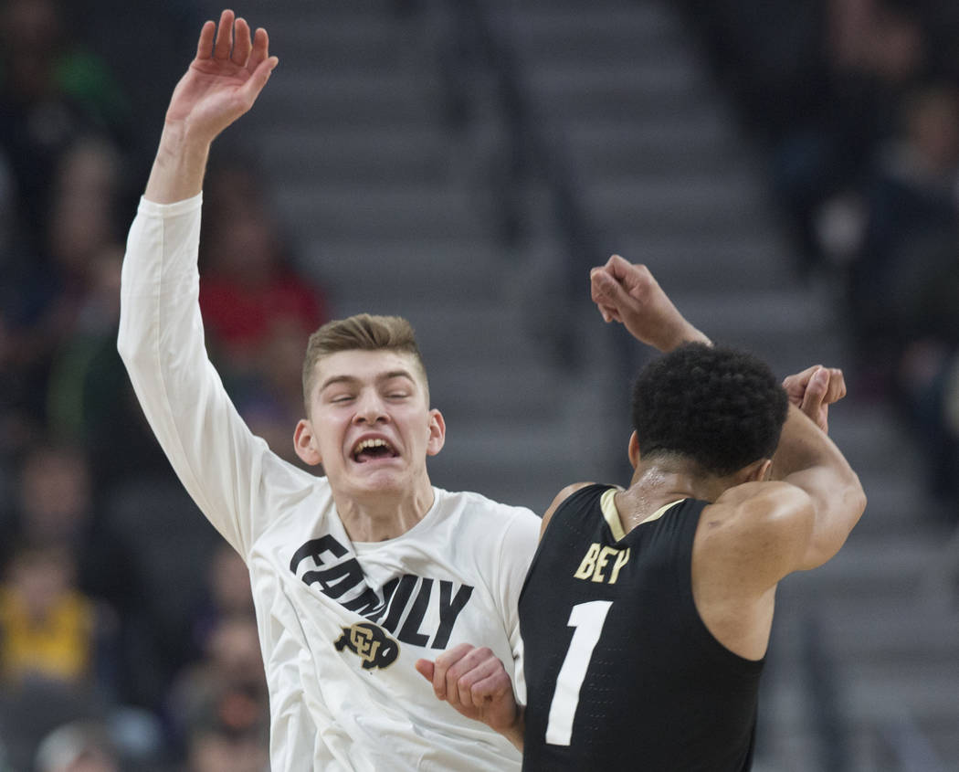 Colorado sophomore guard Tyler Bey (1) celebrates with sophomore guard AJ Martinka (12) after scoring in the first half during the Buffalo's Pac-12 semifinal game with Washington on Friday, March ...