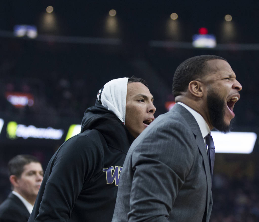 Washington's bench cheers on the Huskies during their Pac-12 semifinal game with Colorado on Friday, March 15, 2019, at T-Mobile Arena, in Las Vegas. (Benjamin Hager Review-Journal) @BenjaminHphoto