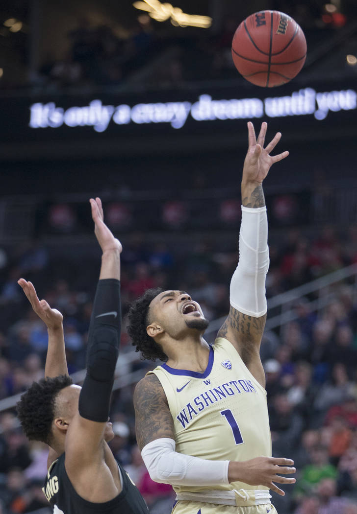 Washington senior guard David Crisp (1) slices to the rim past Colorado junior guard Shane Gatling (0) in the second half during the semifinal game of the Pac-12 tournament on Friday, March 15, 20 ...