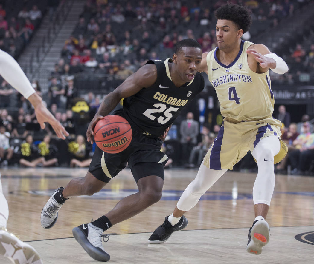Colorado sophomore guard McKinley Wright IV (25) drives past Washington senior guard Matisse Thybulle (4) in the first half during the semifinal game of the Pac-12 tournament on Friday, March 15, ...