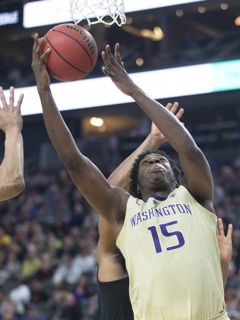 Washington senior forward Noah Dickerson (15) grabs a rebound in the second half during the Huskies Pac-12 semifinal game with Colorado on Friday, March 15, 2019, at T-Mobile Arena, in Las Vegas. ...
