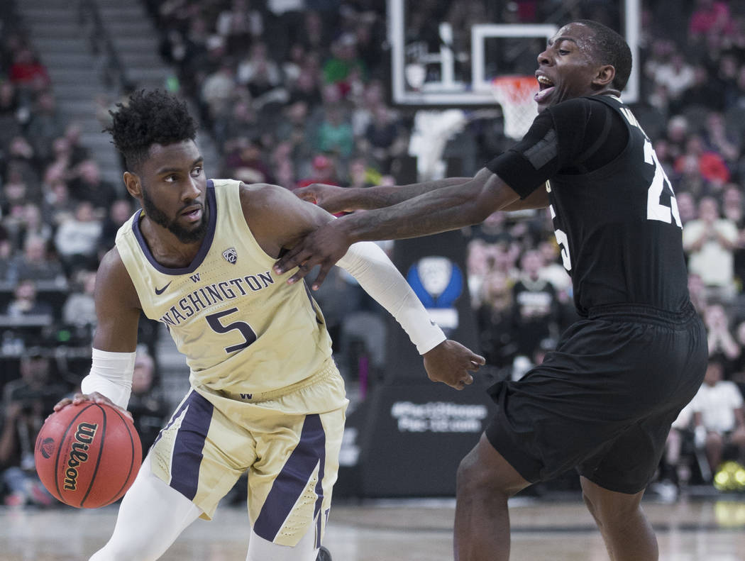 Washington sophomore guard Jaylen Nowell (5) drives past Colorado junior forward Lucas Siewert (23) in the second half during the semifinal game of the Pac-12 tournament on Friday, March 15, 2019, ...