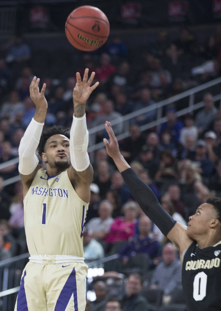 Washington senior guard David Crisp (1) shoots a corner three over Colorado junior guard Shane Gatling (0) in the second half during the semifinal game of the Pac-12 tournament on Friday, March 15 ...