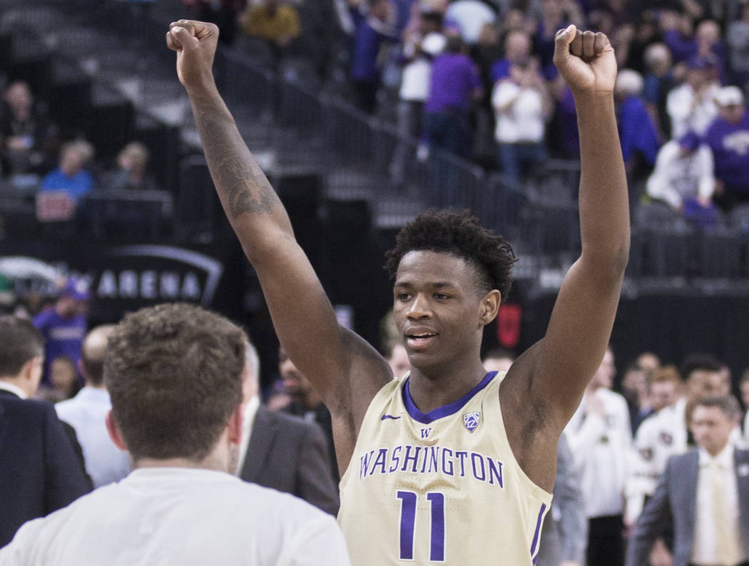 Washington sophomore forward Nahziah Carter (11) celebrates after the Huskies beat Colorado 66-61 during the semifinal game of the Pac-12 tournament on Friday, March 15, 2019, at T-Mobile Arena, ...