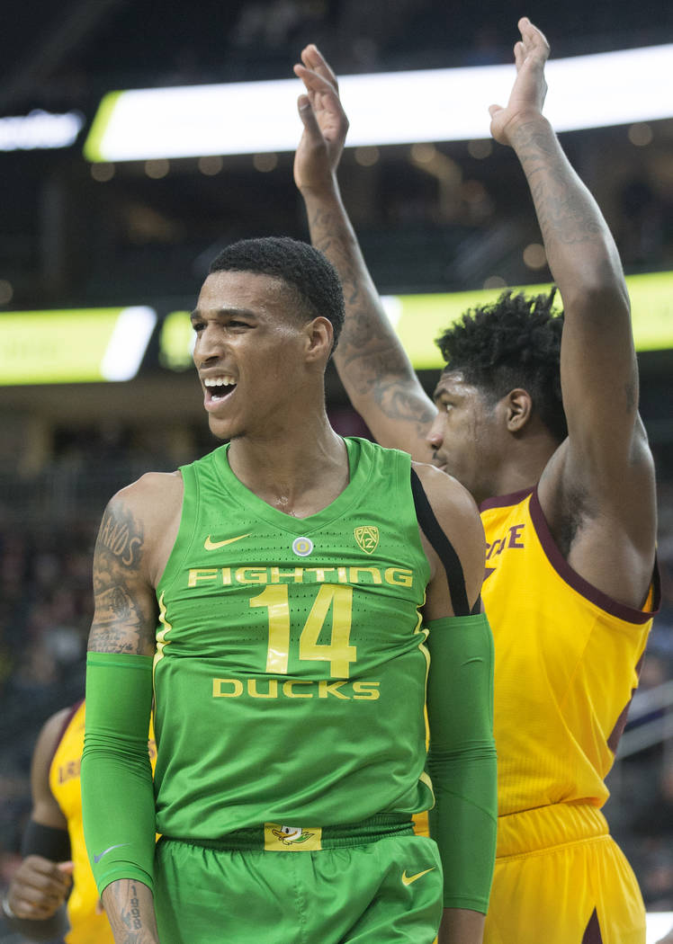 Oregon sophomore forward Kenny Wooten (14) looks at his bench after scoring in the second half during the semifinal game of the Pac-12 tournament with Arizona State on Friday, March 15, 2019, at T ...