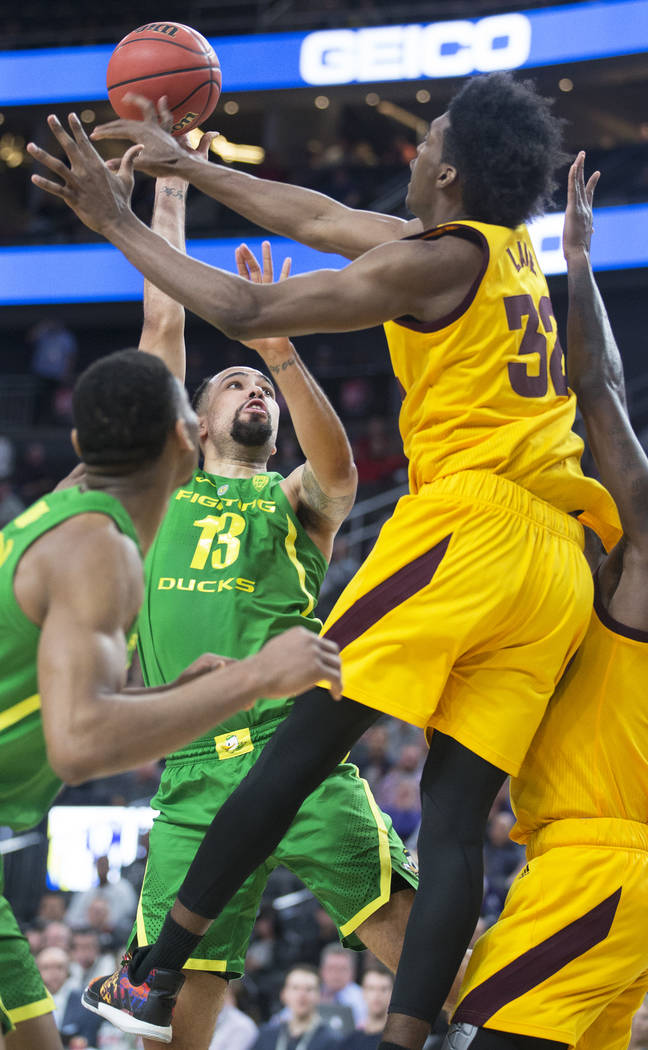 Oregon senior forward Paul White (13) shoots a jump shot over Arizona State senior forward De'Quon Lake (32) in the second half during the semifinal game of the Pac-12 tournament on Friday, March ...