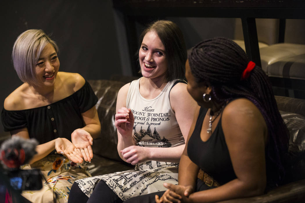 Cosplayer and influencer Stella Chuu, left, talks with grant recipients Giselle Colon, center, and Alesha DeBose while visiting the HyperX Esports Arena at the Luxor as part of the 1,000 Dreams Fu ...